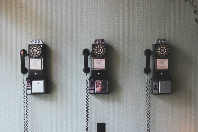 Ladnline phones on a wall